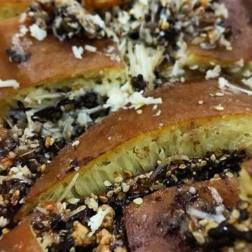 Chocolate, cheese, peanut, and sesame, topped with dough. The best sweet martabak in the city for new year's eve!